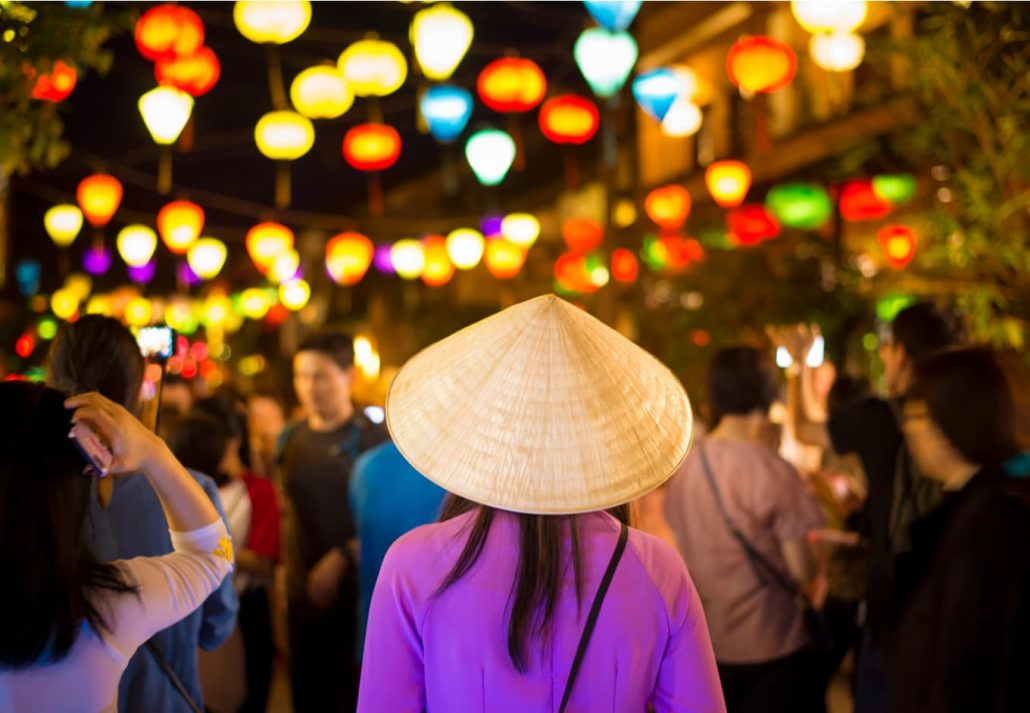 Young woman exploring the Hoi An Night Market, in Vietnam.
