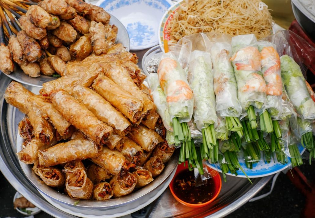 Vitnemese fresh and fried spring rolls on a street food stall.