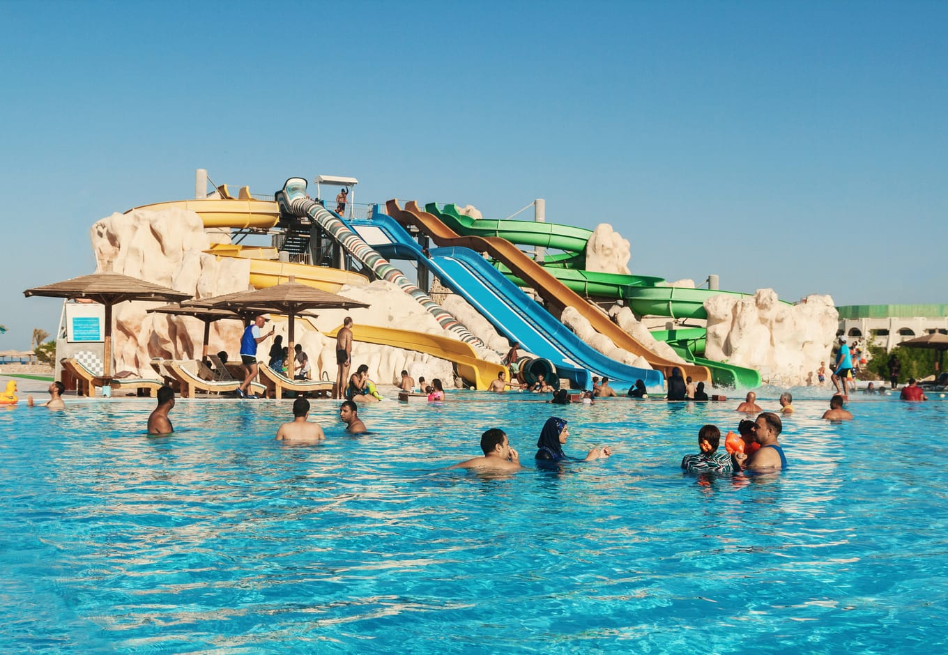Colorful waterslides leading to a pool at the Wild Wadi Water Park, in Dubai.