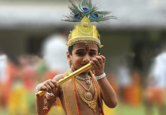 A young boy dressed as Lord Sri Krishna on the Janmashtami festival (Ashtamirohini) day for the procession