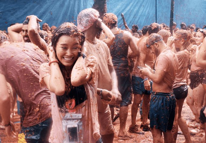 A woman in a battle of Tomatoes in La Tomatina Festival, Bunol, Spain on August 30 , 2017