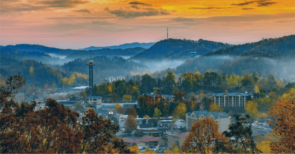 The Space Needle observation tower and the Sky Lift surrounded by the fall foliage in Gatlinburg, Tennessee.