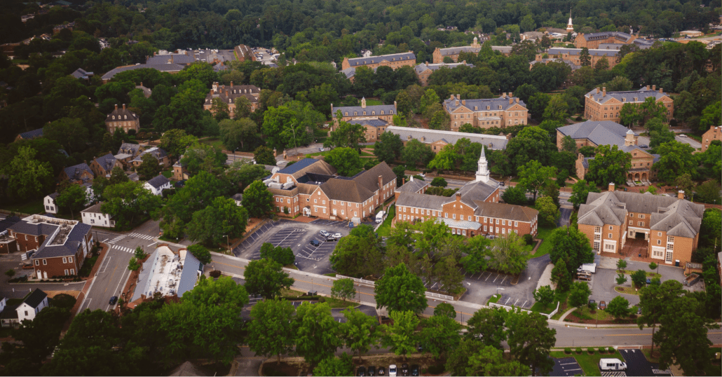 Aerial photography of Colonial Williamsburg showing historic buildings like the Governor's Palace, and the Palace Green.