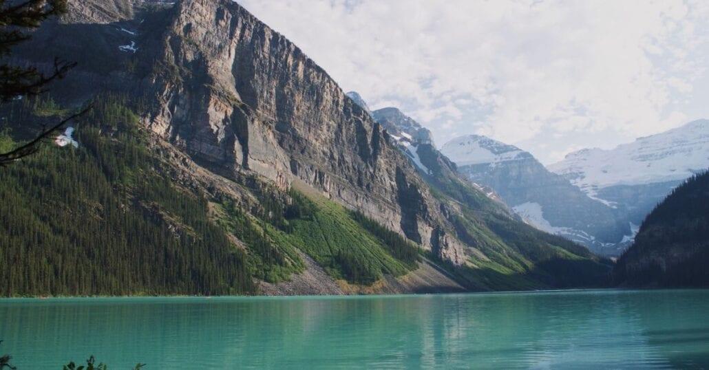 The turquoise waters of Lake Louise framed by a mountainous range at the Banff National Park, in Canada.