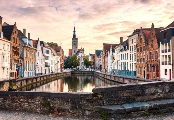 A canal lined with 17th-century houses in Bruges, belgium.