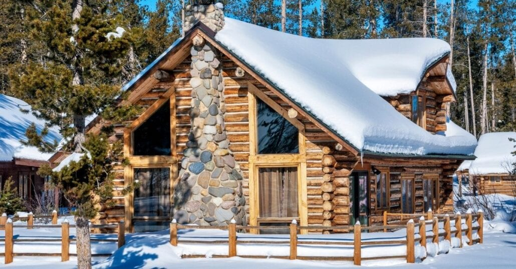 A wooden cabin covered in snow in Idaho.