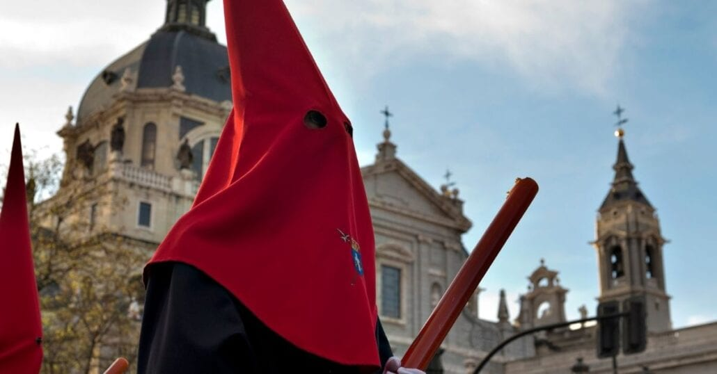 Man wearing a traditional religious costume during an Easter procession in Spain.