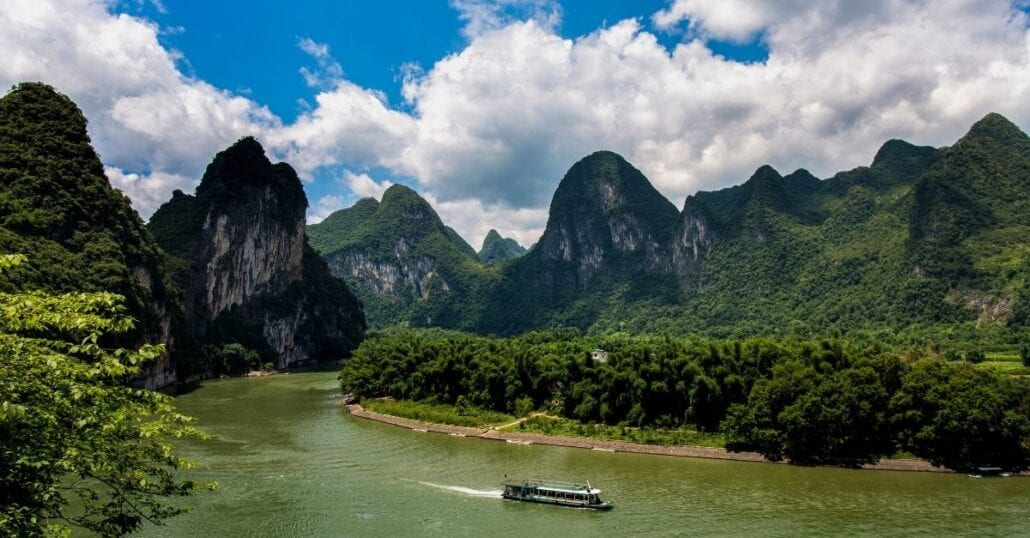View of the Li River bypassed by the green mountains of the Guilin and Lijiang River National Park, in China.