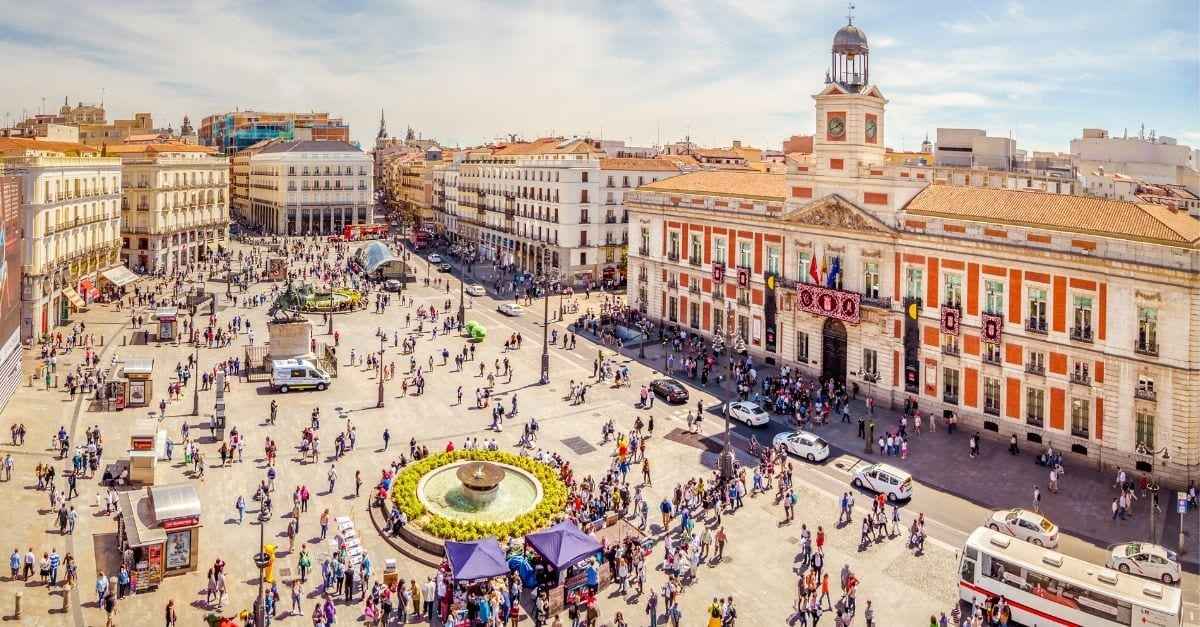 Puerta del Sol square filled with people.