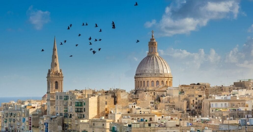 View of birds flying over Valletta, the capital of Malta, during a clear day.