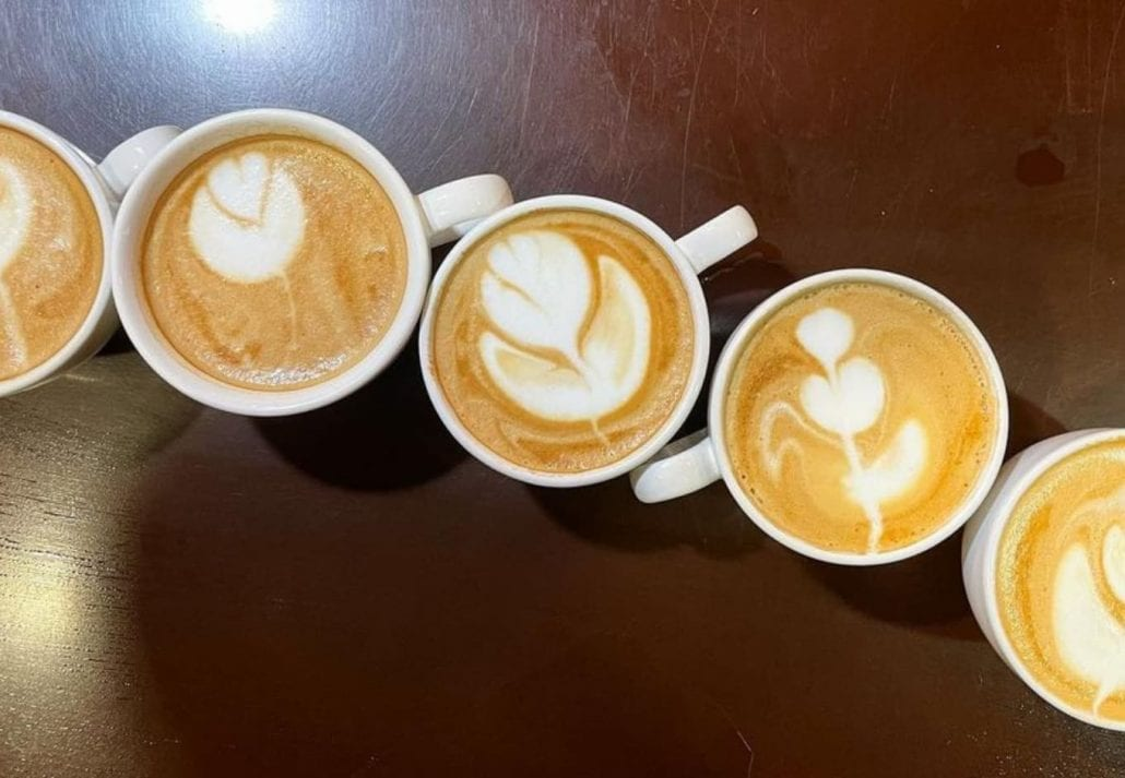 5 lattes on top of a table at R&R Coffee Cafe, Colorado.