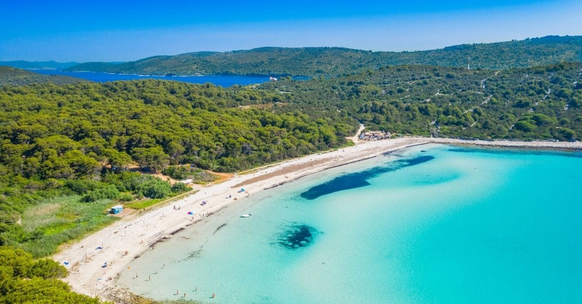 Aerial view of the blue transparent water of the Sakarun Beach, in Croatia.
