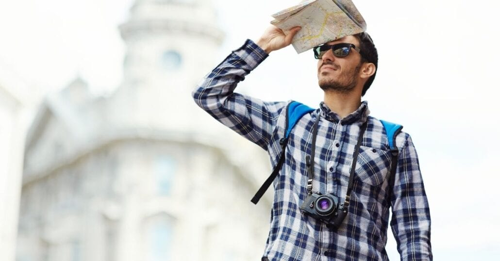 A tourist holding a map while looking for something.