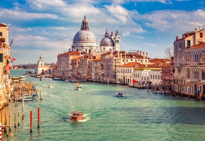 The Grand Canal, in Venice, lined by historic terracota buldings.