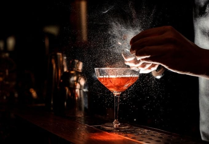 A drink being made by a bartender.
