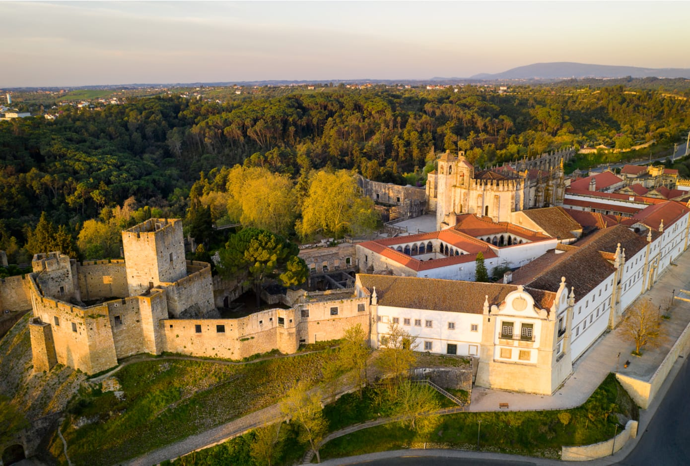 Aerial drone view of Convent of Christ in Tomar at sunrise, Portugal
