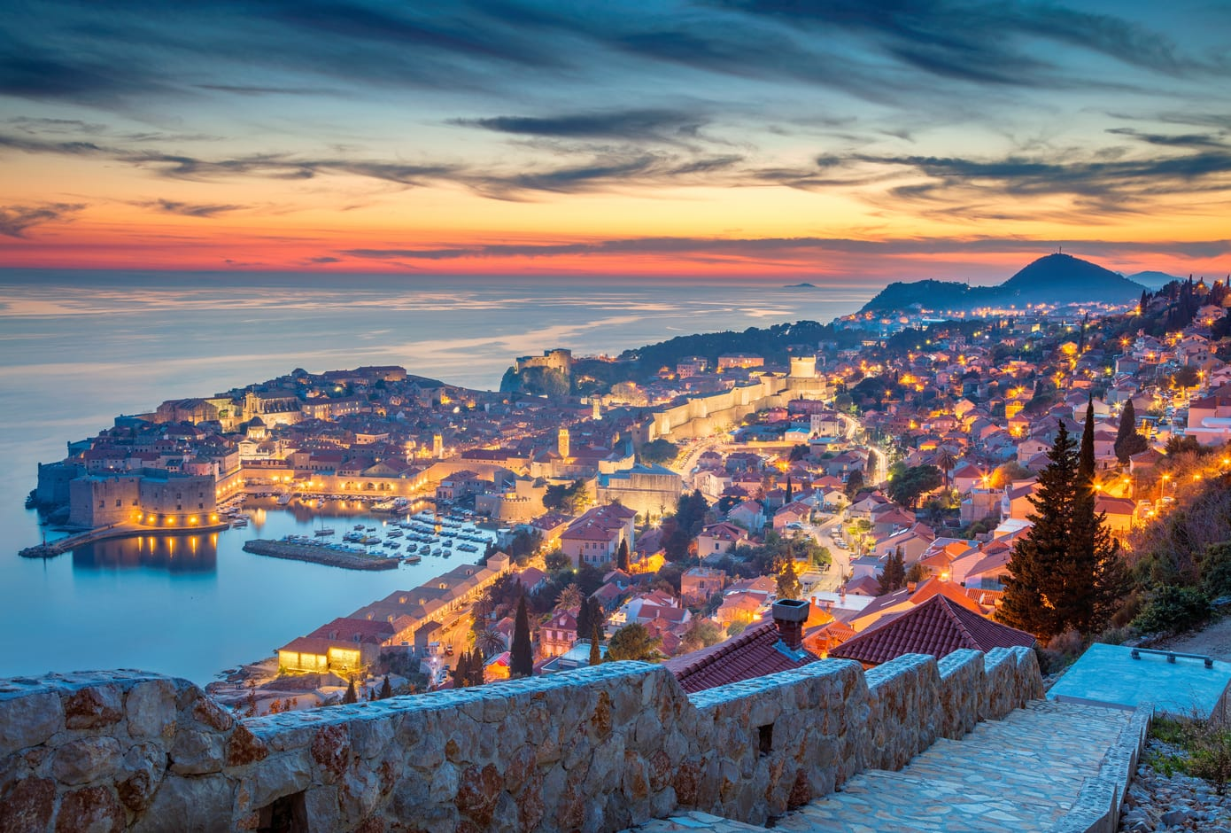 A yellow, blue, and pink sunset in Dubrovnik, Croatia.
