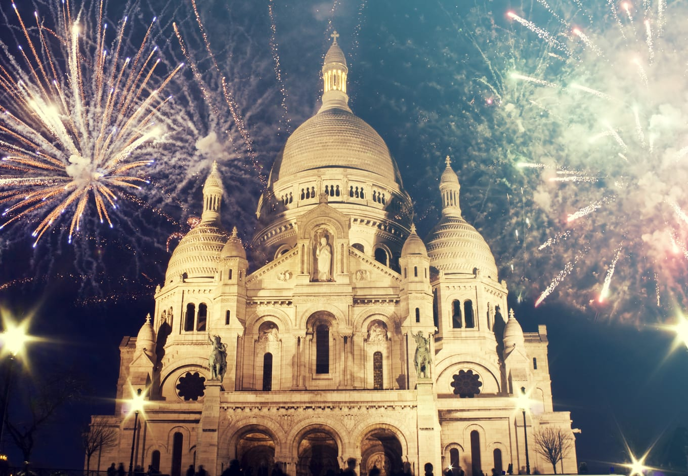 The Sacre Coeur church with fireworks, during the New Year in Paris, France