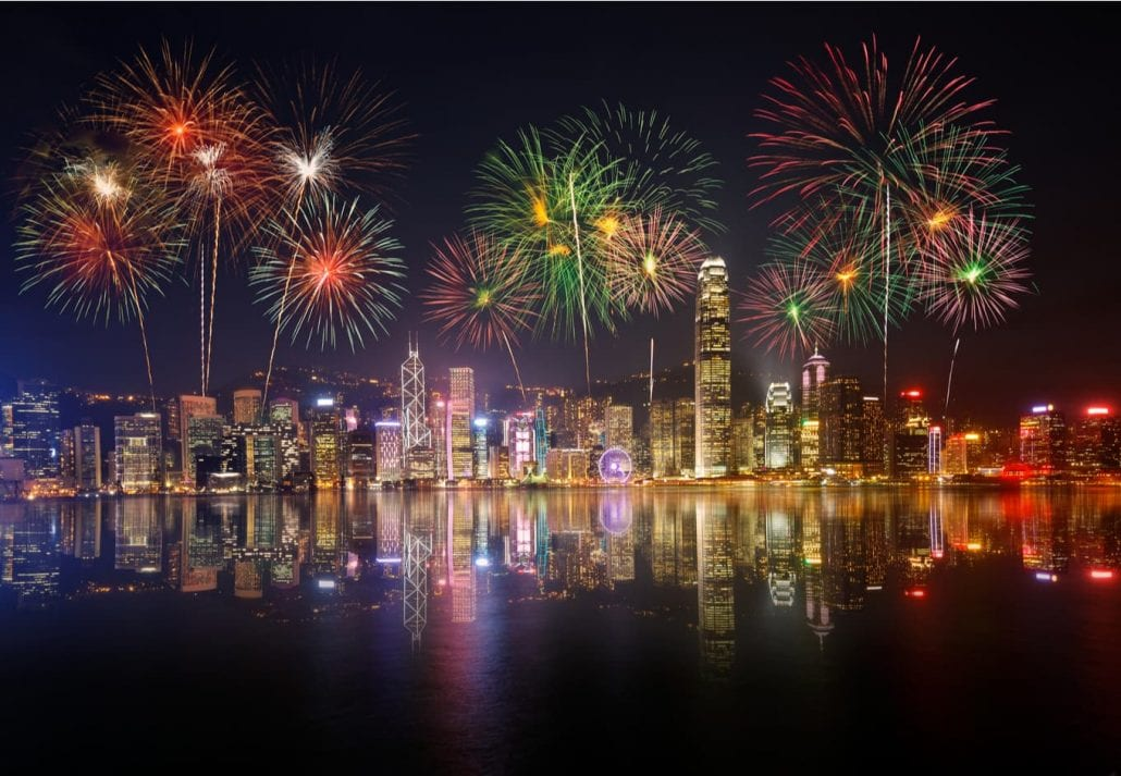 Night view and fireworks in Victoria Harbour, Hong Kong.