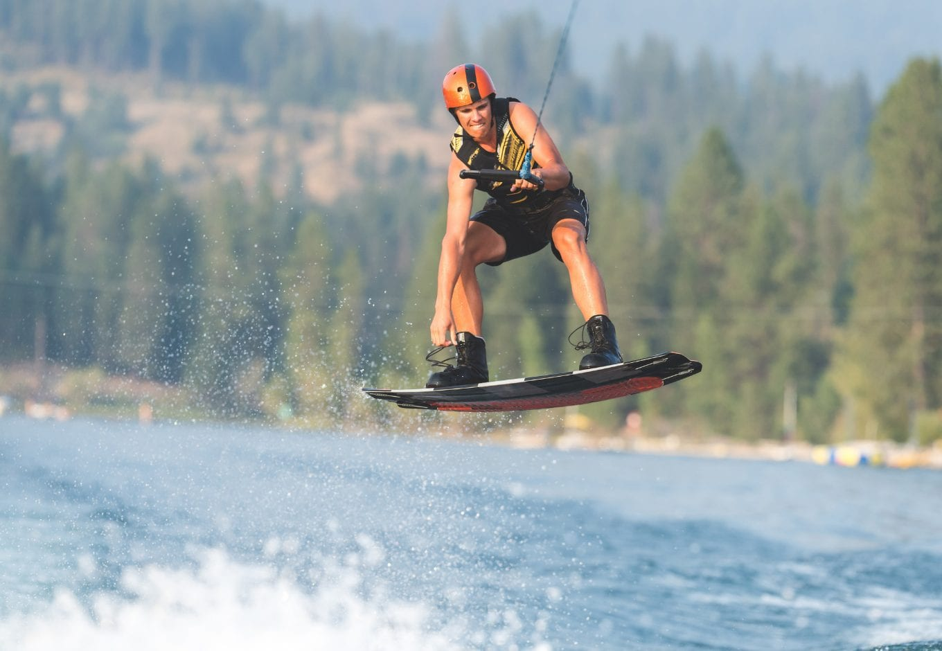 Woman wakeboarding on a lake.