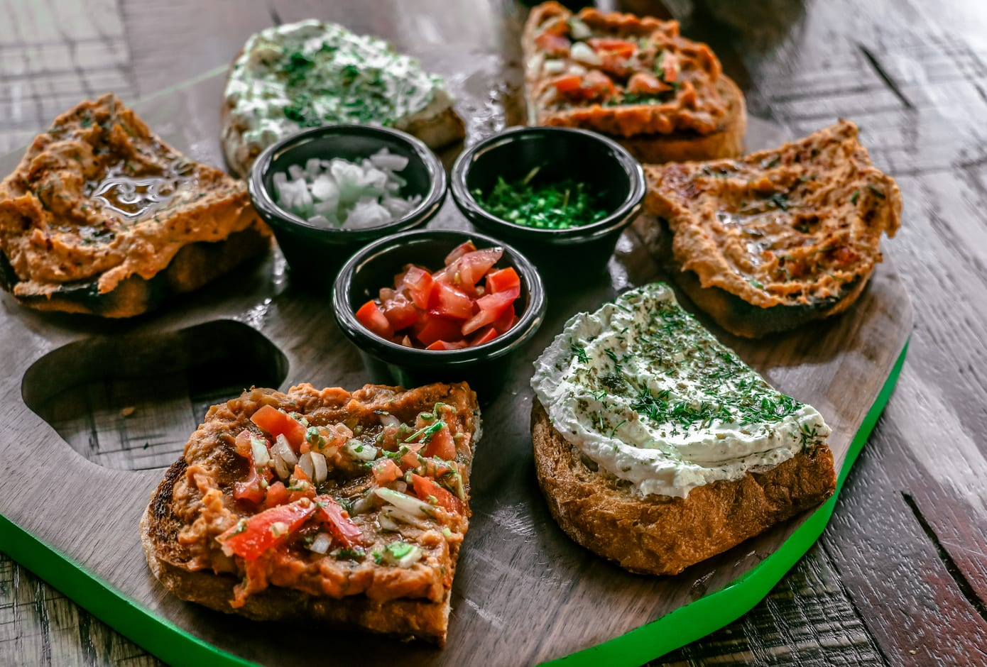 Variety of Middle Eastern  sandwiches with spreads.