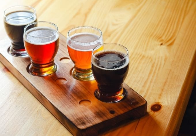A set of four craft beers.