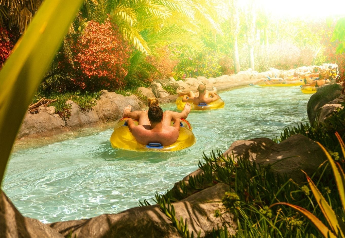 Two people on the lazy river at the Siam Park, Tenerife, Spain.
