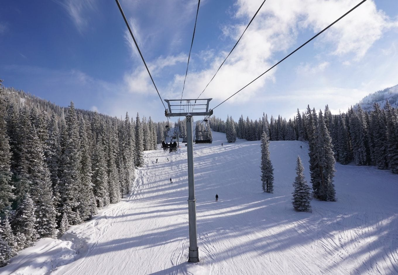 Ski lifts in the snowy mountains of Aspen Snowmass, Colorado.