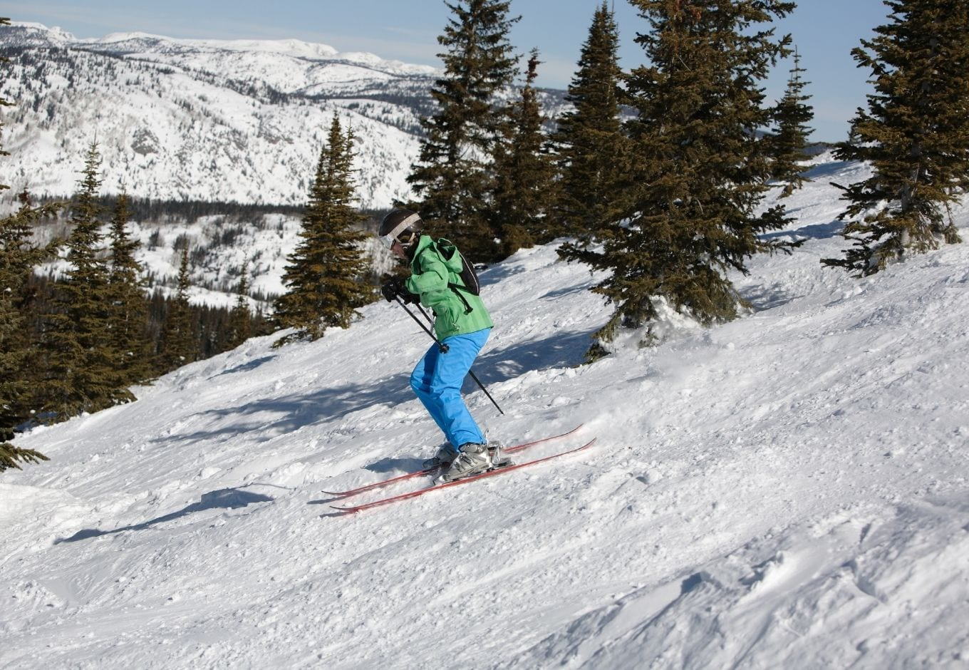 Person downhill skiing at the Steamboat Resort, Colorado.