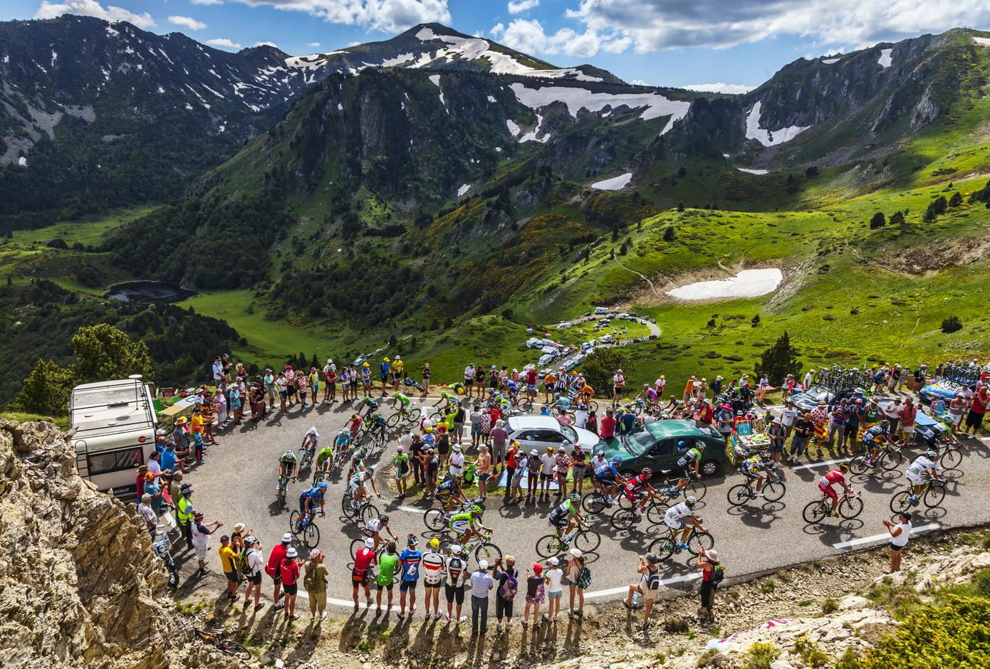 The peloton climbing the road to Col de Pailheres in Pyrenees Mountains during the stage 8 of Tour de France, 2013.