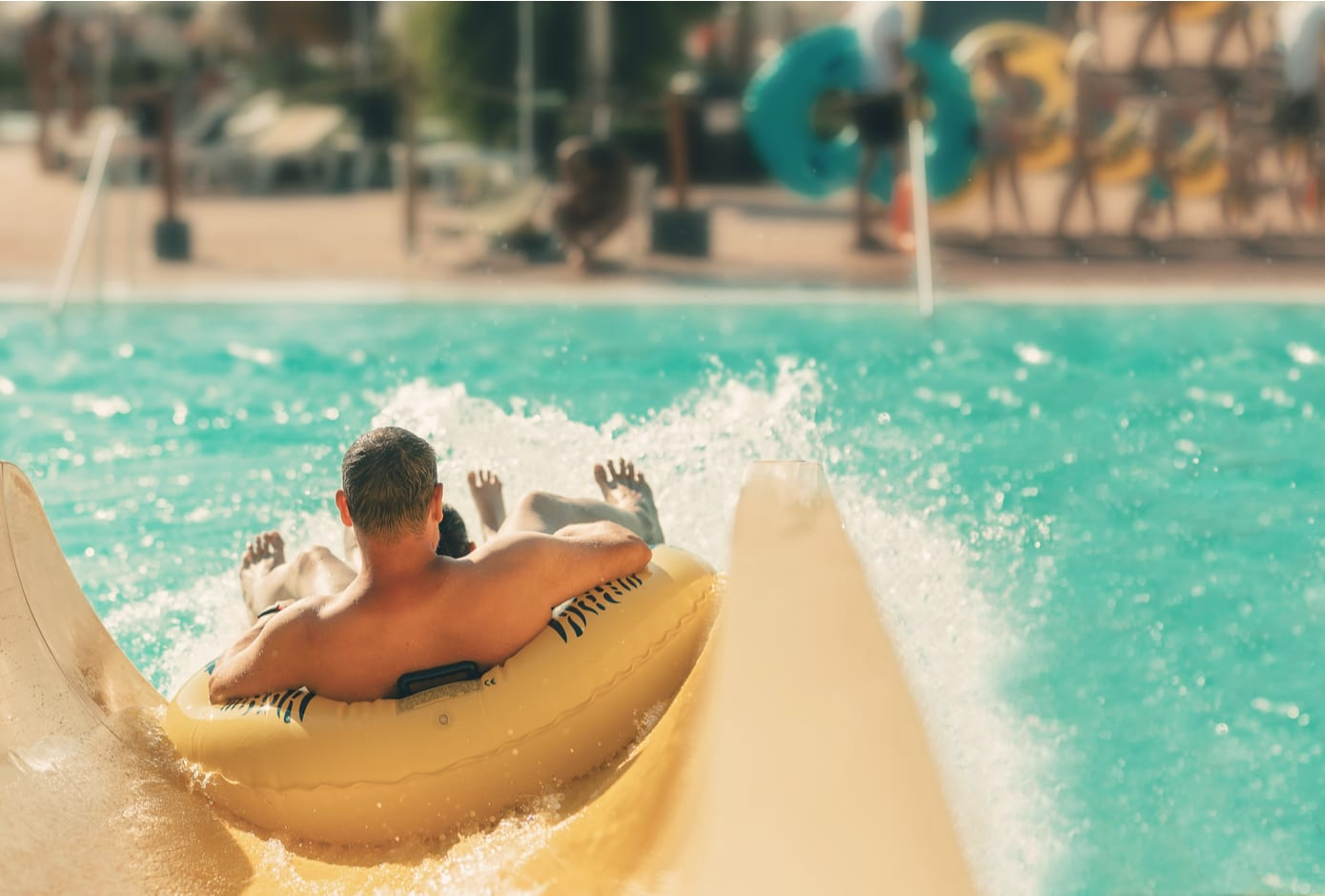 Two boys at a water slide.