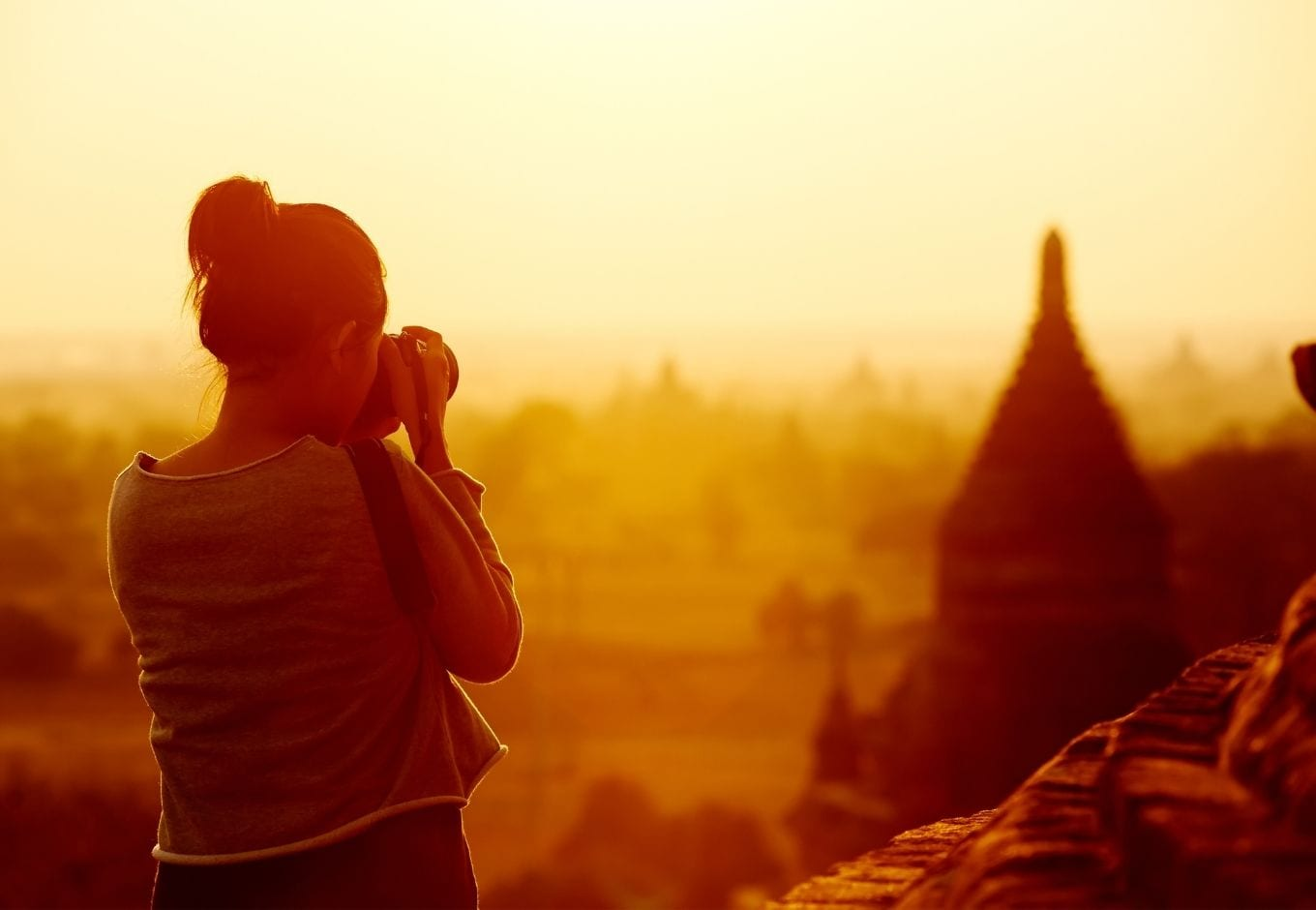 Female traveler photographing the Bagan Temples, at Myanmar.
