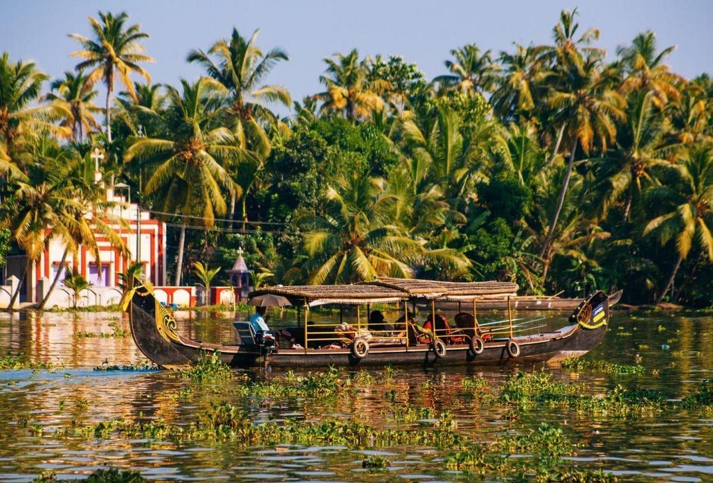 A house boat transports tourists around the backwaters in Alleppey, India.