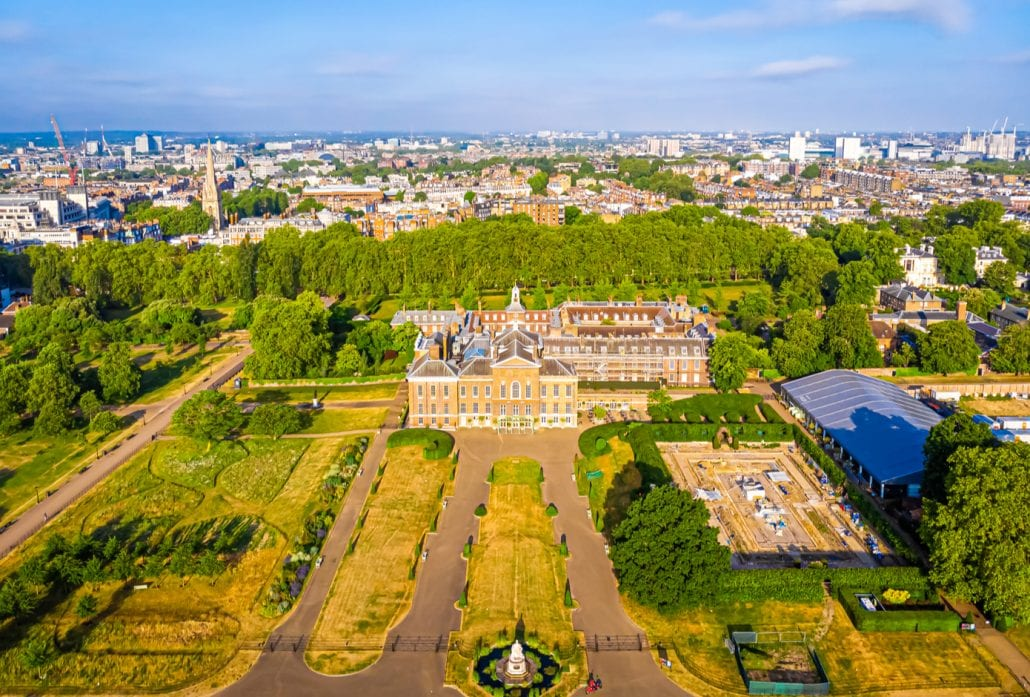 The Kensington Palace and its ornate gardens viewed from the top.