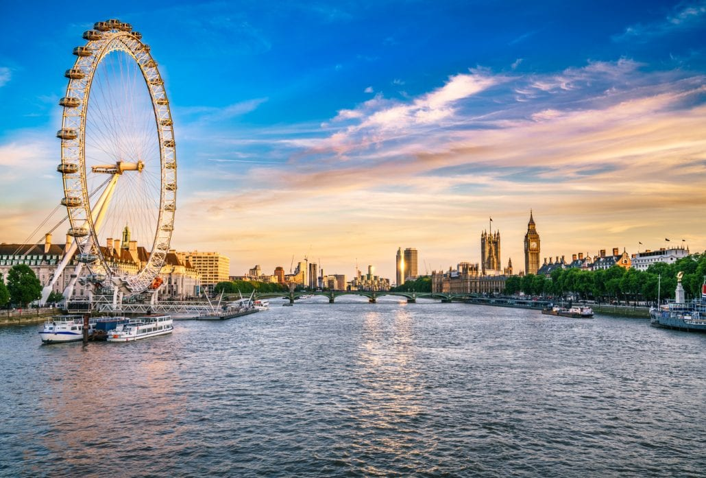 The London Eye overlooking the River Thames with the Big Ben at the backgorund.