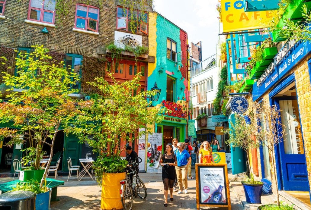 A view of colourful buildings in Neals Yard during the day. Neals Yard hidden passage near Covent Garden in London, United Kingdom.