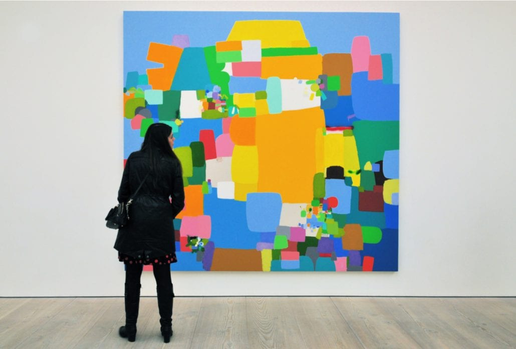 A visitor views Amansalva, a painting by Costa Rica artist Federico Herrero at the Saatchi Gallery in Chelsea, London, UK.