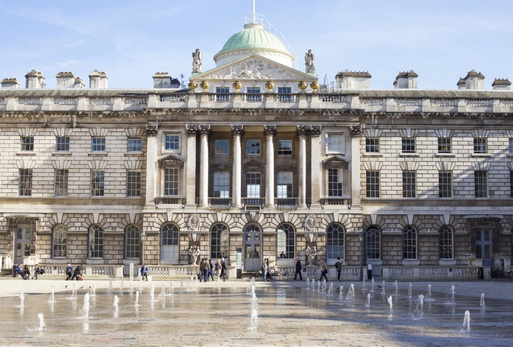 the Somerset House and its dancing spurting water fountains in London, UK on a sunny day.