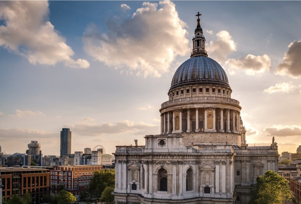 Urban skyline with St. Paul Cathedral at sunset. London, United Kingdom.