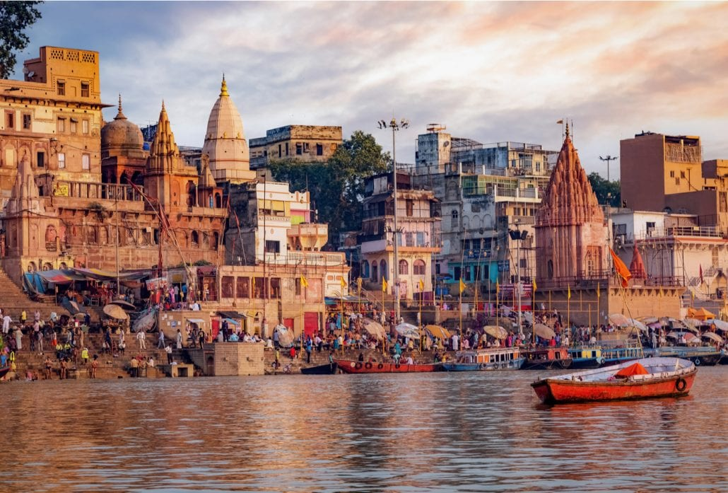 Ancient Varanasi city architecture at sunset overlooking the River Ganges.
