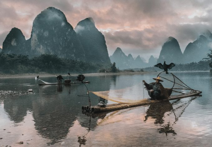 Two fishermen on the Li River, in China.