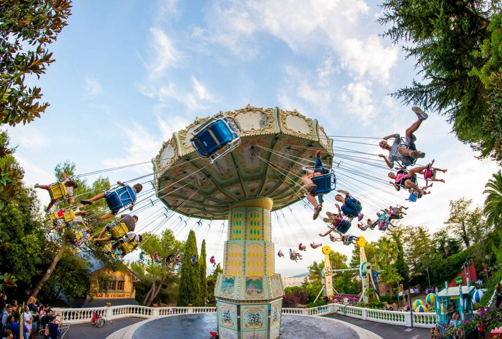 Kids swinging on a ride at the Tibidabo Amusement Park at Barcelona, Spain.