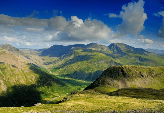 English Lake District mountains in summer. The view from Red Pike over the Mosedale Valley towards Yewbarrow, Great Gable, Kirk Fell, and the Scafell Range
