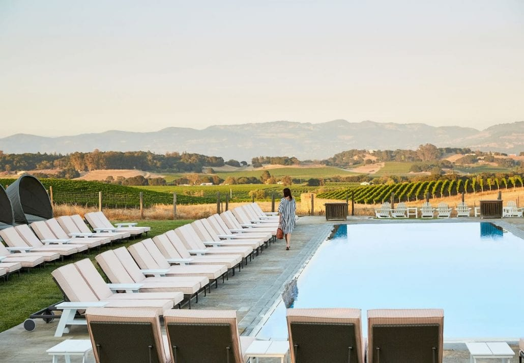 The swimming pool surrounded by vineyards at Carnerors Resort, in Sonoma, California.