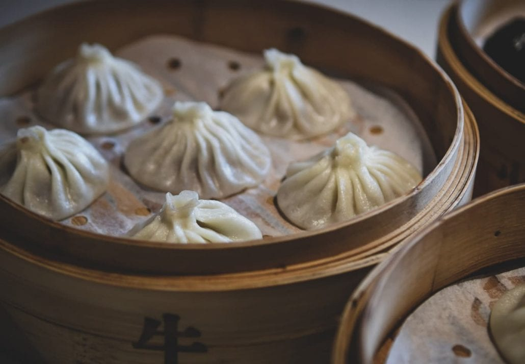 Chinese dumplings in a  bamboo steamer box.