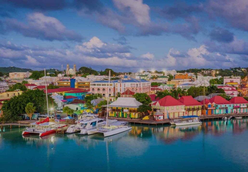 Colorful houses by the ocean in Saint John, the capital city of Antigua Barbuda.