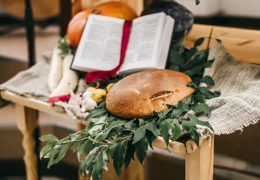 Fruits and vegetables for harvest in the church with Bible