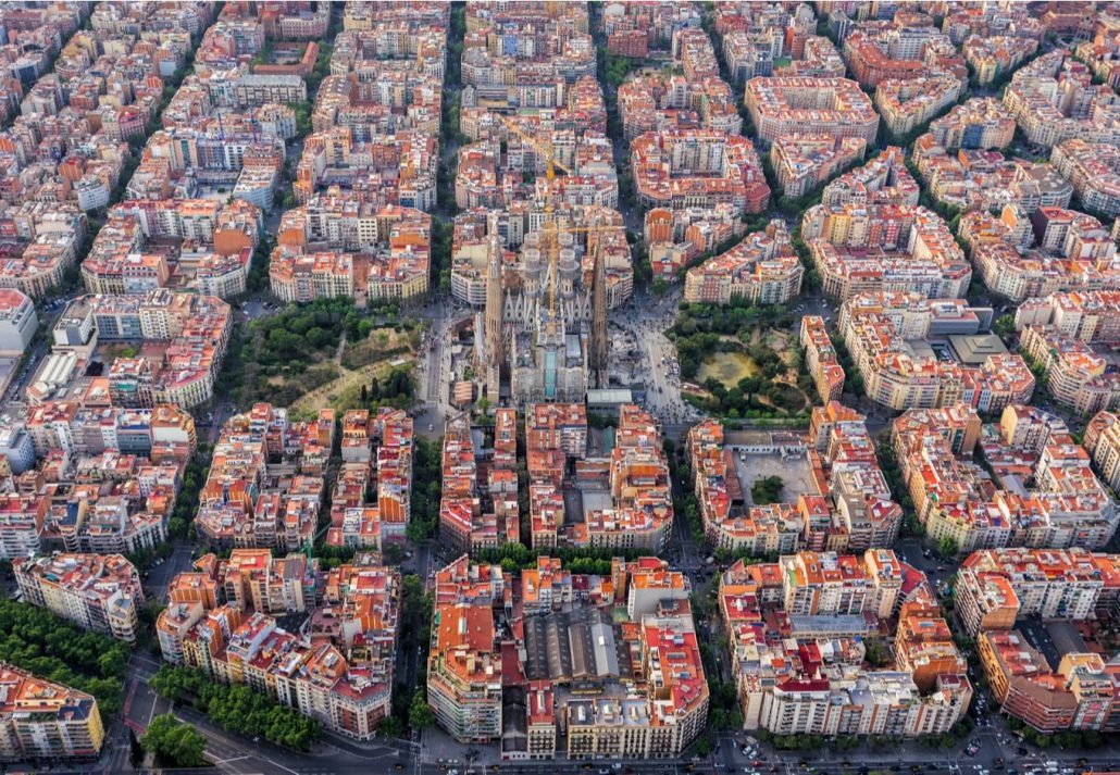 Aerial view of Barcelona's Eixample neighbourhood with the Sagrada Familia in the middle.