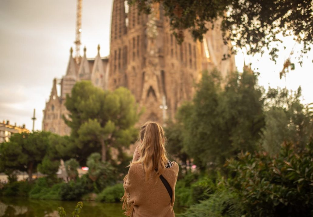A girl from the back enjoying the view of the Sagrada Familia, in Barcelona, Spain. familia