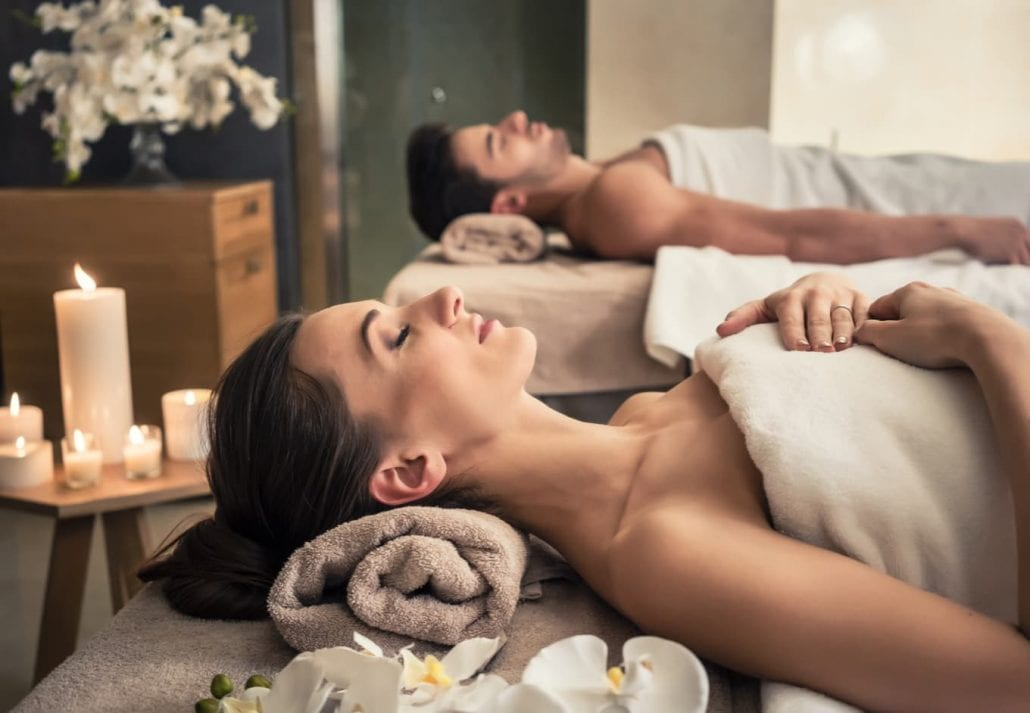 Couple getting a massage on a spa.